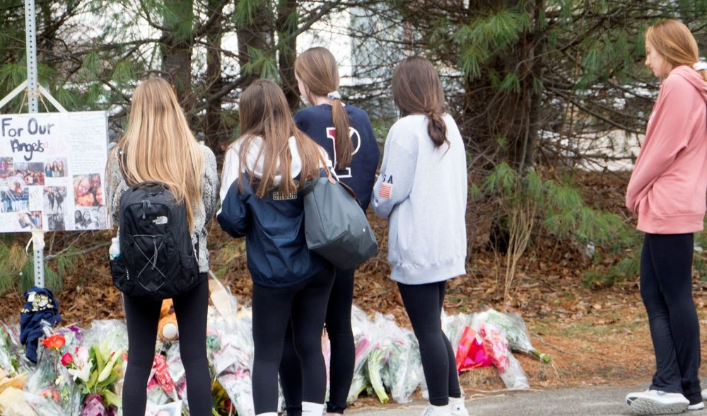 Students gather outside the memorial to two Needham High juniors. (Max Larkin/WBUR)
