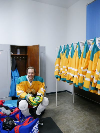 Alex sits fully dressed before a hockey game in North Korea. (Courtesy Alex Frecon)