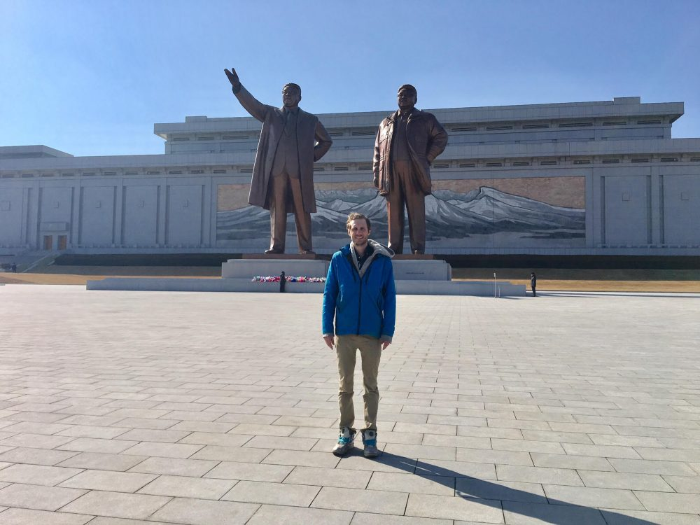 Alex stands in front of the statues of Kim ll-sung and Kim Jong-il at North Korea's Mansu Hill Grand Monument. (Courtesy Alex Frecon)