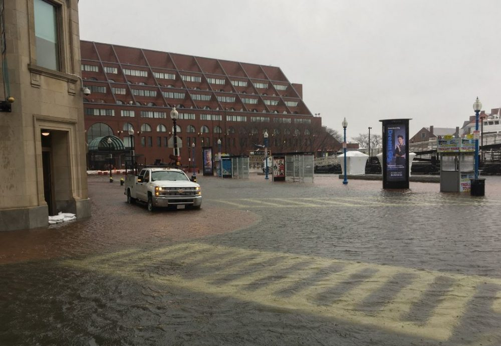 Flooding near the New England Aquarium in Boston. (Robin Lubbock/WBUR)