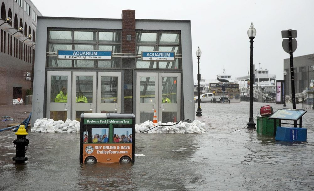 Sandbags hold back water at the entrance to the Aquarium MBTA station during the March 2 nor'easter. (Robin Lubbock/WBUR)
