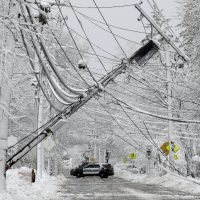 A police vehicle blocks a road near downed power lines on March 8 in Natick, Mass. (Steven Senne/AP)
