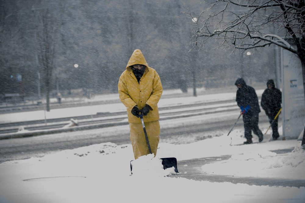 Shovelers work their way around the corner of Commonwealth Avenue and Mountfort Street in Boston. (Jesse Costa/WBUR)