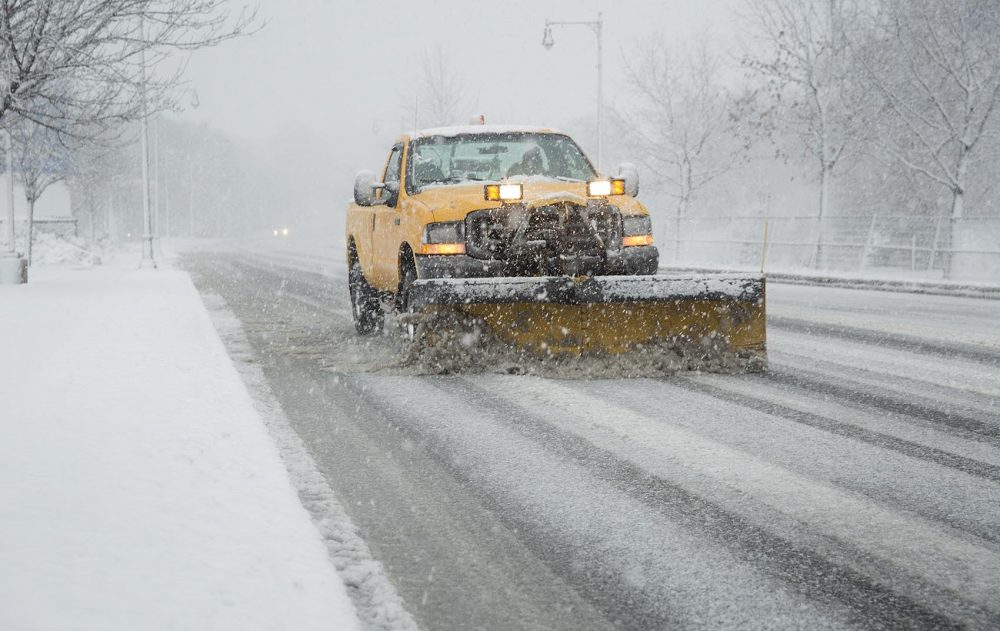 A snowplow clears a deserted Route 3 in Cambridge during Tuesday morning's commute. (Robin Lubbock/WBUR)