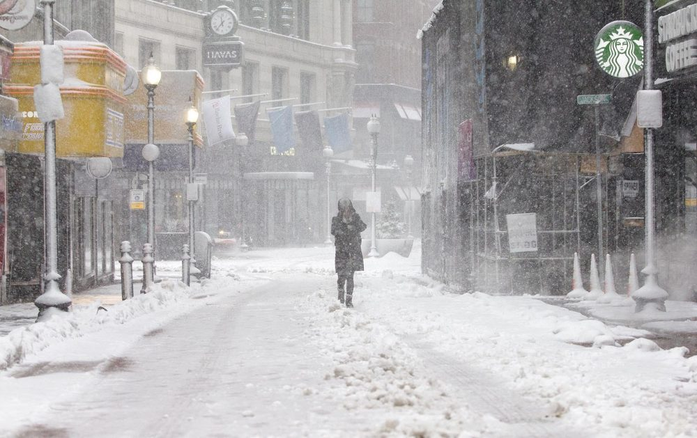 A pedestrian struggles up Winter Street in Boston in the middle of the storm. (Robin Lubbock/WBUR)
