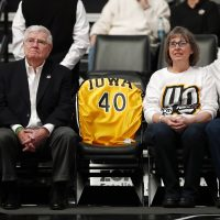 Patty and Mike Street, pictured here on the right at an Iowa-Purdue game in January, are the mother and father of Chris Street, whose school free throw record still stands. (Charlie Neibergall/AP)