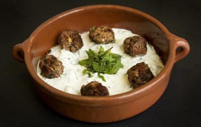 Lamb-feta-mint meatballs with yogurt sauce and toasted walnuts, from chef Kathy Gunst. (Robin Lubbock/WBUR)