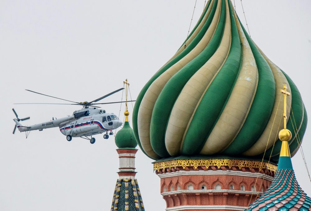 One of the helicopters of Russian President Vladimir Putin flies near St. Basil's Cathedral in Moscow on March 26, 2018, while preparing to land at The Kremlin. (Mladen Antonov/AFP/Getty Images)