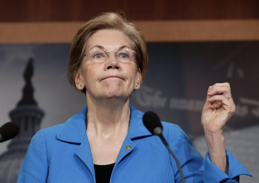 Sen. Elizabeth Warren, D-Mass., expresses her opposition to a move in the Senate that would roll back some of the safeguards Congress put into place after a financial crisis rocked the nation's economy 10 years ago, during a news conference in Washington Tuesday. (J. Scott Applewhite/AP)