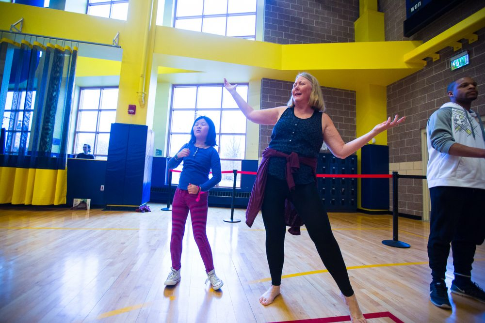 At the Ailey community dance workshop, the author strikes a pose as her daughter pretends not to notice. (Courtesy Robert Torres/Celebrity Series)