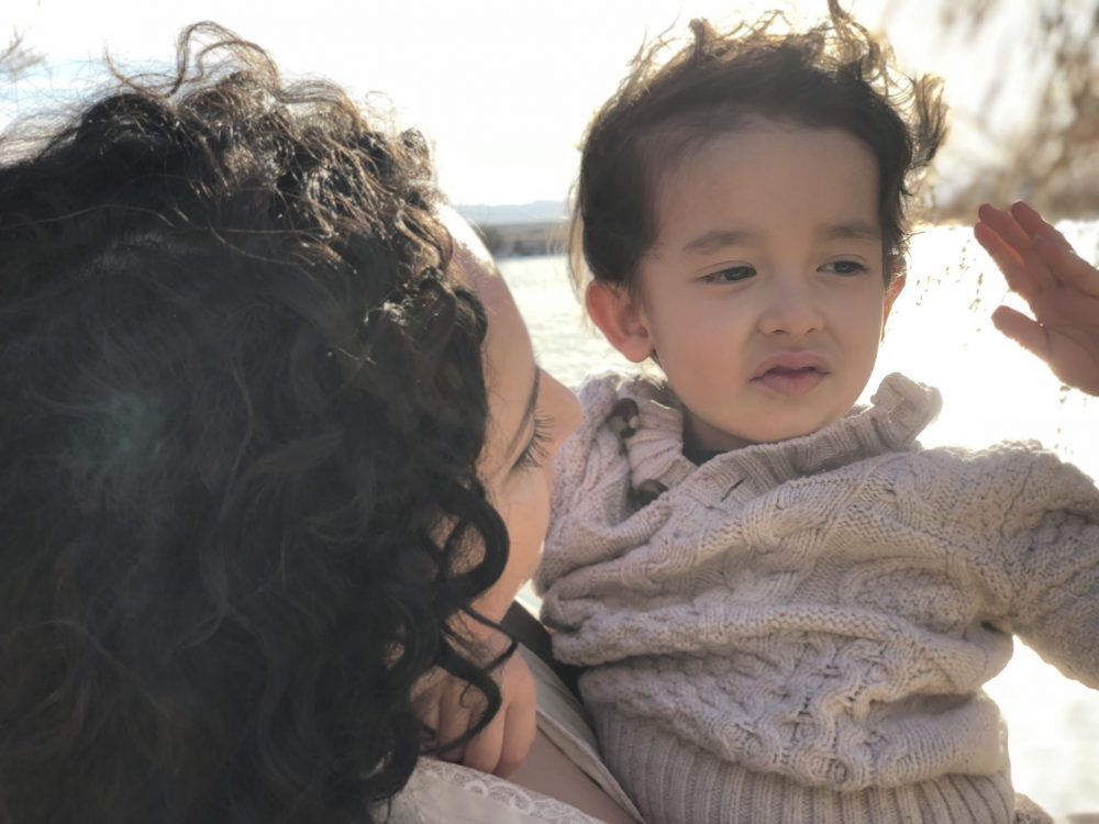 Reporter Maria Garcia with her son. (Courtesy)