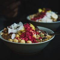 Healthy fruit bowls with coconut, berries and nuts. (Arek Adeoye/Unsplash)