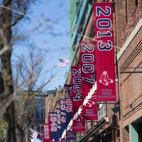The Red Sox World Series banners hang on the outside of Fenway Park on Yawkey Way. (Jesse Costa/WBUR)