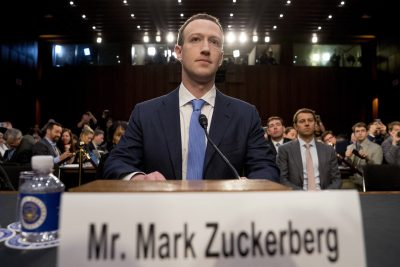 Facebook CEO Mark Zuckerberg arrives to testify before a joint hearing of the Commerce and Judiciary Committees on Capitol Hill in Washington on Tuesday. (Andrew Harnik/AP)