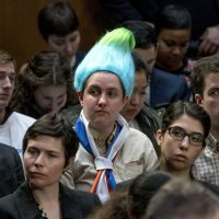 Amanda Werner seen wearing a blue and green pointy wig, aiming to look like a Russian troll, as Facebook CEO Mark Zuckerberg testifies before a joint hearing of the Commerce and Judiciary Committees on Capitol Hill in Washington, Tuesday, April 10, 2018, about the use of Facebook data to target American voters in the 2016 election. (Andrew Harnik/AP)