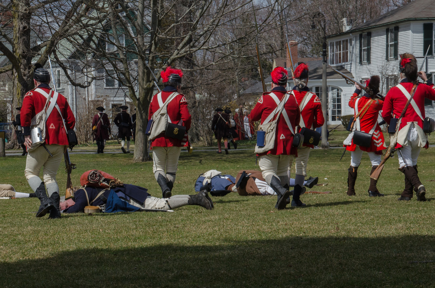 As the rehearsal concludes, the Redcoats march through the fallen on Lexington Green. (Sharon Brody/WBUR)