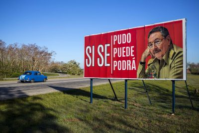 "A car drives by a billboard that reads in Spanish ""It was, is and will be done"" with a picture of Cuba's President Raul Castro on the outskirts of Havana, Cuba, Wednesday, April 18, 2018. Cuba's legislature opened the two-day session that is to elect a successor to President Castro. (Desmond Boylan/AP)"