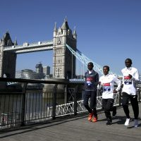 Kenya's Daniel Wanjiru, Ethiopia's Kenenisa Bekele, Kenya's Eliud Kipchoge and Ethiopia's Guye Adola pose for a picture in front of Tower Bridge during the media day at the Tower Hotel, London, Thursday, April 19, 2018. The London Marathon will be raced Sunday. (Steven Paston/PA via AP)