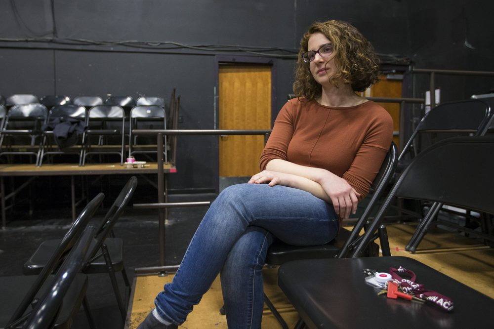 Teacher Lynda Bachman watches as her students rehearse at the Gann Academy. (Jesse Costa/WBUR)