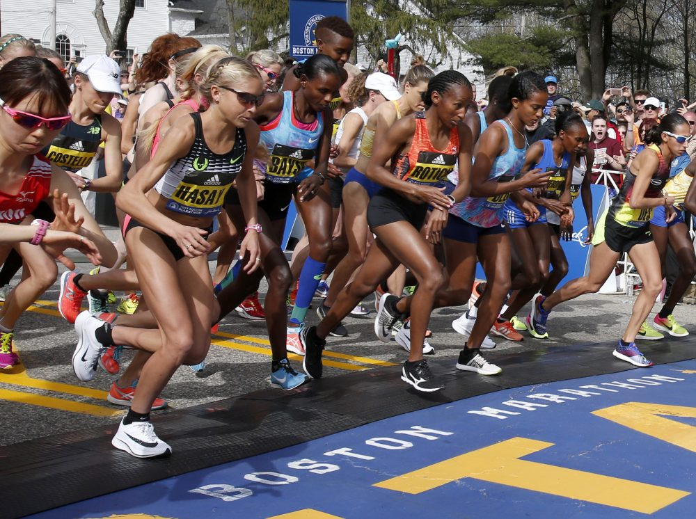 In this Monday, April 17, 2017 photo, Jordan Hasay, left, of Beaverton, Ore., breaks from the starting line with the elite women at the start of the 2017 Boston Marathon in Hopkinton, Mass. It was Hasay's first competition at the 26.2-mile distance, and she finished in third place in the women's division. (AP Photo/Mary Schwalm)