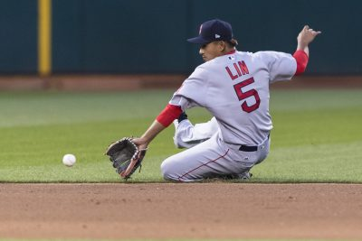 Boston Red Sox shortstop Tzu-Wei Lin fields a grounder by Oakland Athletics' Khris Davis during the sixth inning of a baseball game in Oakland, Calif., Saturday, April 21, 2018. (AP Photo/John Hefti)