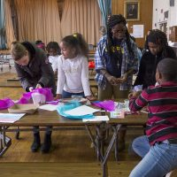 "Teacher Natasha Gordon works with students during the Grew Elementary ""acceleration academy."" (Max Larkin/WBUR)"