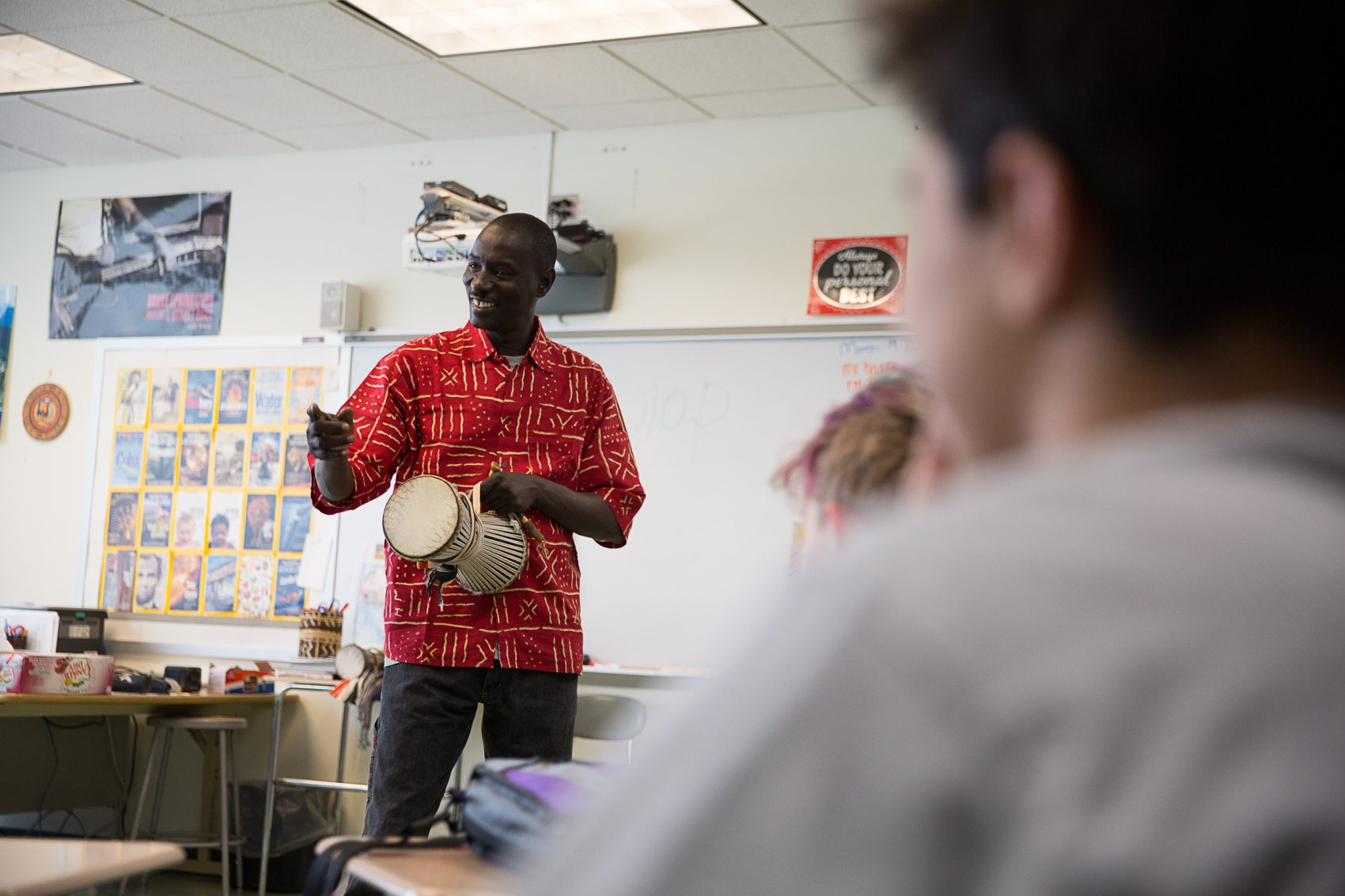 Holding one of his talking drums, Senegalese drum soloist Massamba Diop leads a classroom workshop at Roger Ludlowe Middle School in Fairfield, Connecticut on March 23, 2018. (Ryan Caron King/Connecticut Public Radio)