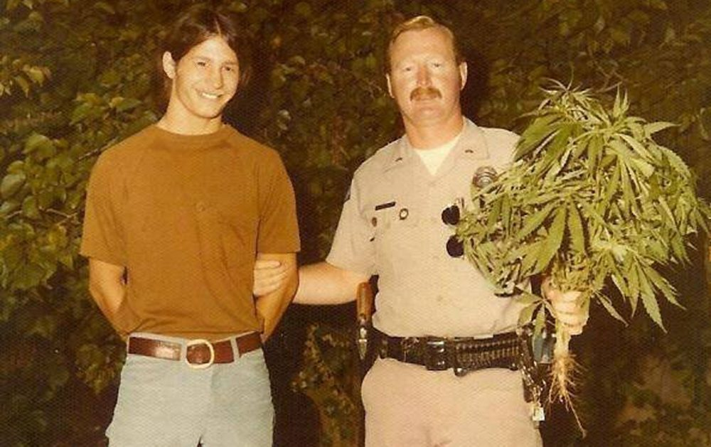 Johnny Grandizio, left, and Officer Bob Winterstein, in 1975, in Huntington Beach, California. Winterstein arrested Grandizio for that enormous marijuana plant, but the charges were later dropped. (Family Photo)
