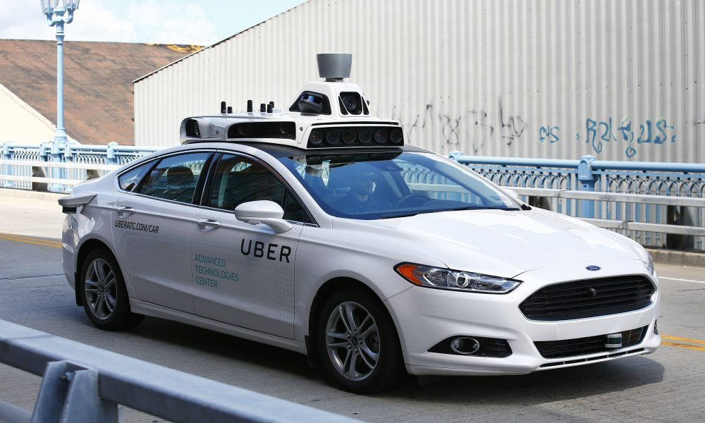 A self-driving Ford Fusion hybrid car is test driven, Thursday, Aug. 18, 2016, in Pittsburgh. (AP Photo/Jared Wickerham)