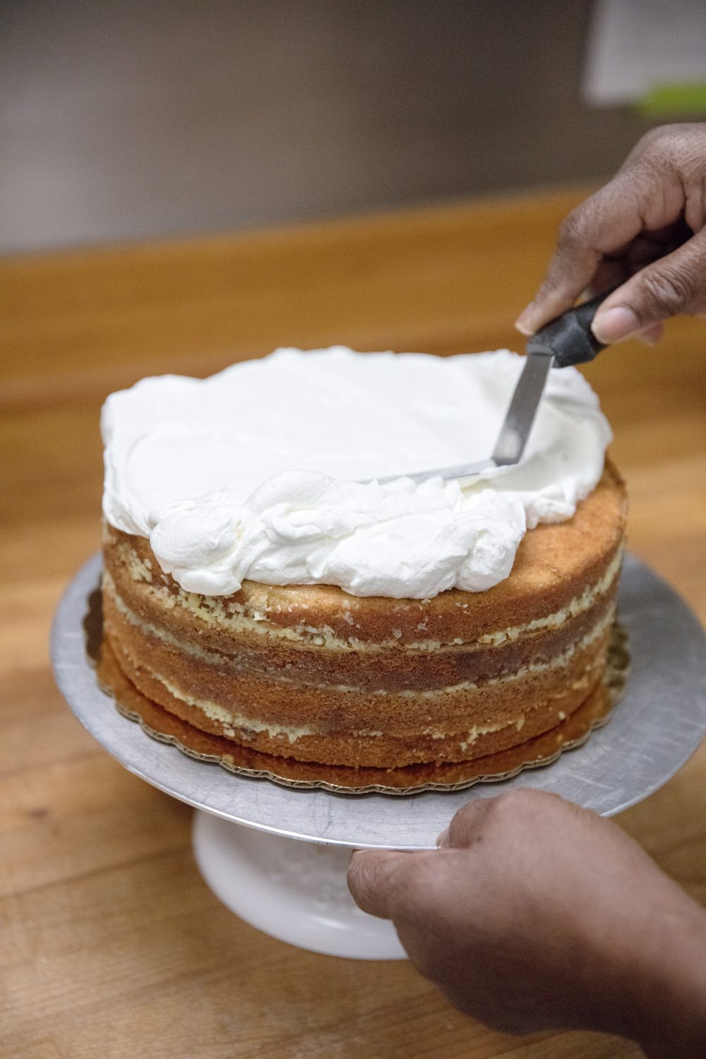 Dolester Miles puts the icing on her coconut pecan cake. (Courtesy Carry Norton)