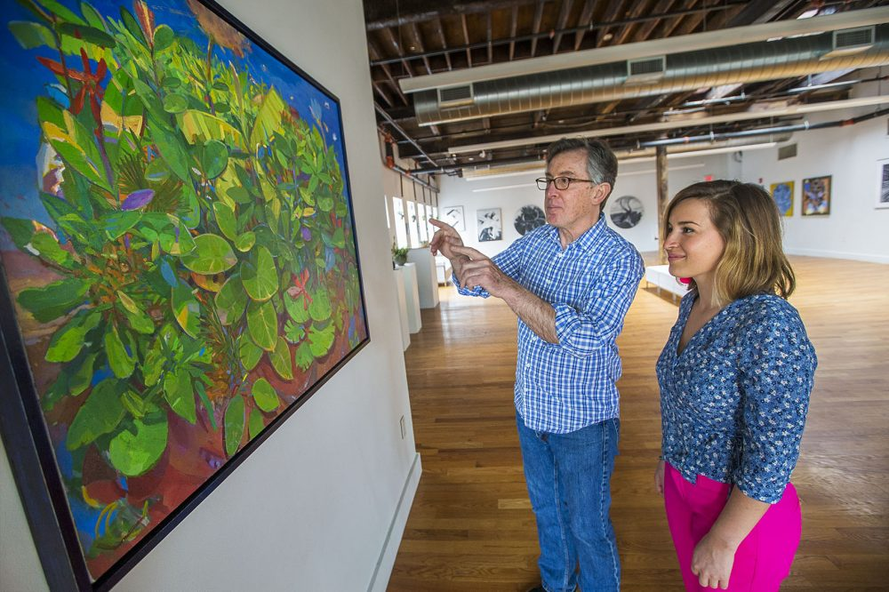 "Artist Enrique Flores-Galbis describes what went into paint his work, ""Tiger, Tiger"" to his daughter curator Olivia Ives-Flores. (Jesse Costa/WBUR)"