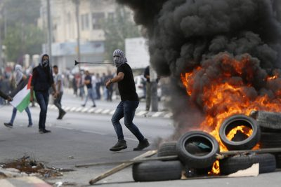 Palestinians clash with Israeli troops following a protest against the U.S. decision to relocate it's Israeli embassy to Jerusalem, in the West Bank city of Bethlehem, Monday, May 14, 2018. (Majdi Mohammed/AP)