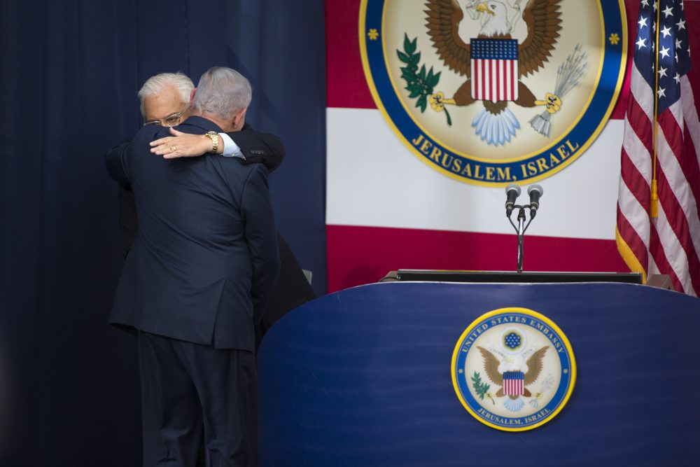 U.S. ambassador to Israel David Friedman and Israel's Prime Minister Benjamin Netanyahu embrace onstage during the opening of the U.S. Embassy in Jerusalem on May 14, 2018 in Jerusalem, Israel. Trump recognized Jerusalem as Israel's capital in December, and announced an embassy move from Tel Aviv, prompting deadly protests in Gaza. (Lior Mizrahi/Getty Images,)