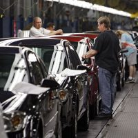 In this Tuesday, June 15, 2010, file photo, workers at General Motors' Lordstown Assembly plant in Lordstown, Ohio, put the final touches on Chevy Cobalts. (Mark Duncan, File/AP)