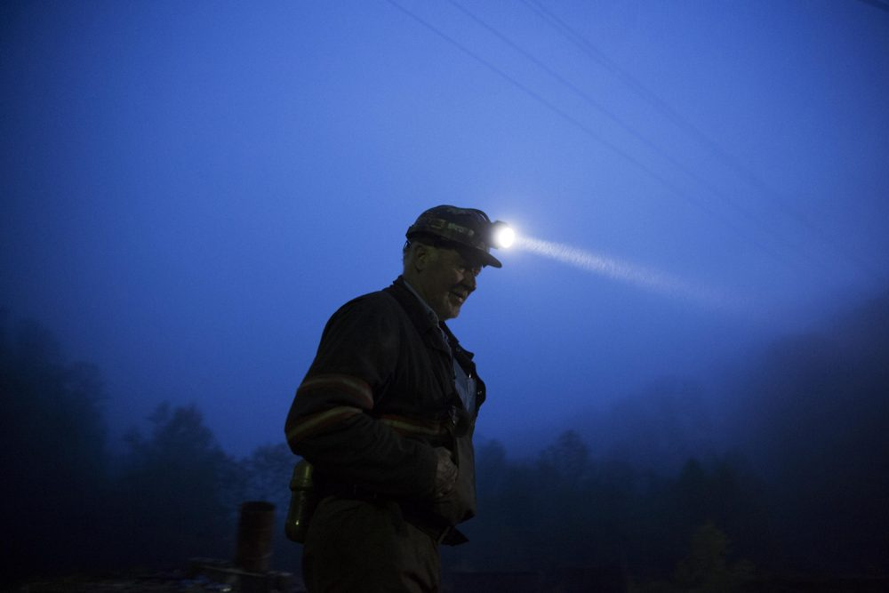 In this May 2016 photo, coal miner Scott Tiller prepares to head into an underground mine less than 40-inches high at dusk in Welch, W.Va. (David Goldman/AP)
