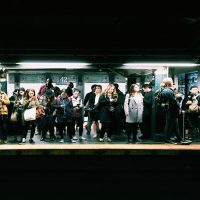 A crowd waiting for the train in the New York City subway. (Eddi Aguirre/Unsplash)
