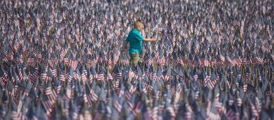 A young boy walks down the path through the annual Memorial Day flag garden on the Boston Common. (Jesse Costa/WBUR)