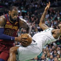 Cleveland Cavaliers forward LeBron James (23) drives against the defense of Boston Celtics forward Marcus Morris during the first quarter of Game 1 of the NBA basketball Eastern Conference Finals, Sunday, May 13, 2018, in Boston. (Michael Dwyer/AP)