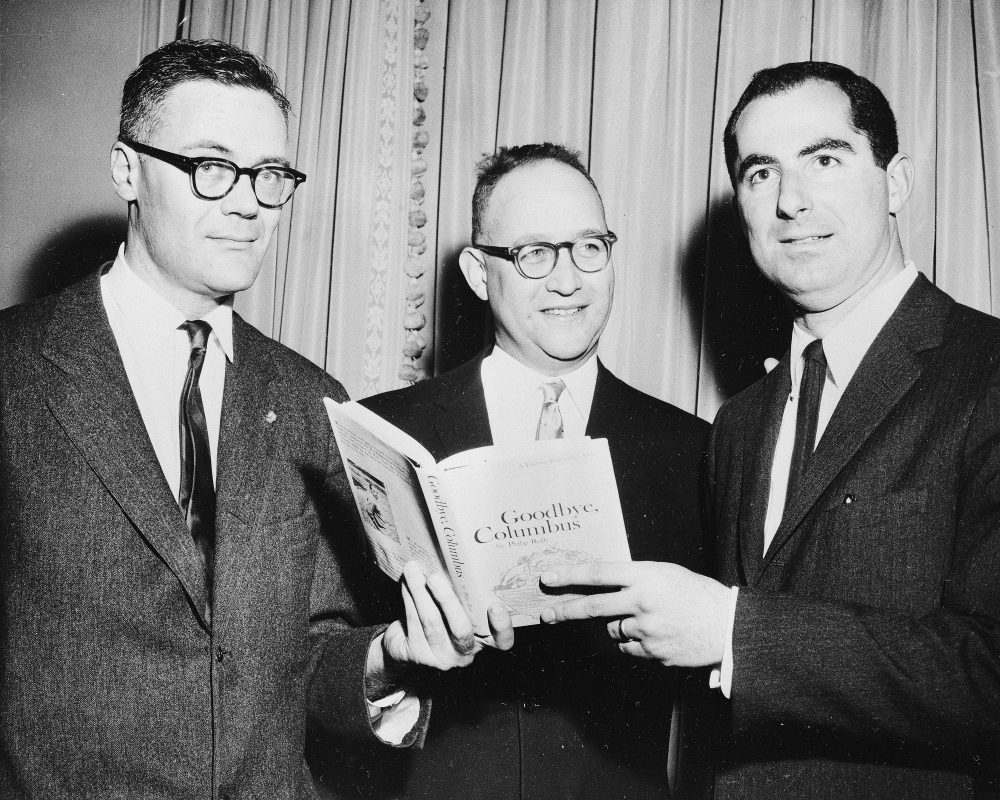 "In this March 24, 1960 file photo, the three winners of the National Book Award, Robert Lowell, from left, awarded for the most distinguished book of poetry, Richard Ellmann, won in the nonfiction category, and Philip Roth, received the award in the fiction category for his book ""Goodbye, Columbus,"" pose at the Astor Hotel in New York City. (AP)"