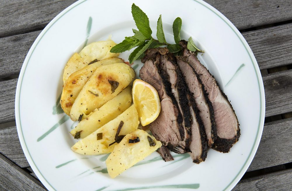 Grilled leg of lamb with Greek-style lemon and oregano potatoes, from chef Kathy Gunst. (Robin Lubbock/WBUR)