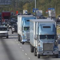 In this photo taken Monday, Oct. 29,, 2012 trucks travel along Interstate 75 near Stockbridge, Ga. (John Bazemore/AP)