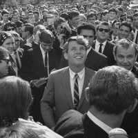 In this June 7, 1966 photo, Sen. Robert F. Kennedy is surrounded by students and newsmen as he tours Stellenbosch, South Africa during five-day visit to South Africa as the guest of the multiracial National Union of South African students. (Dennis Lee Royle/AP file photo)