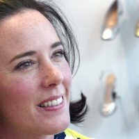 In this May 13, 2004 file photo, designer Kate Spade poses with shoes from her next collection in New York. Law enforcement officials say Tuesday, June 5, 2018, that New York fashion designer Kate Spade has been found dead in her apartment in an apparent suicide. (Bebeto Matthews/AP)