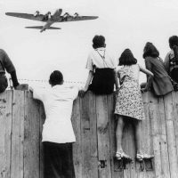 West Berlin children at Tempelhof airport watch fleets of U.S. airplanes bringing in supplies to circumvent the Russian blockade in this undated photo. The airlift began June 25, 1948, and continued for 11 months. (AP Photo)