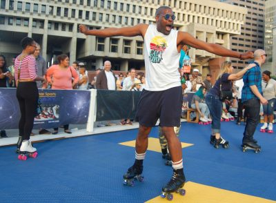 A man roller skates at the Donna Summer Roller Disco in 2015. (Greg Cook/WBUR)