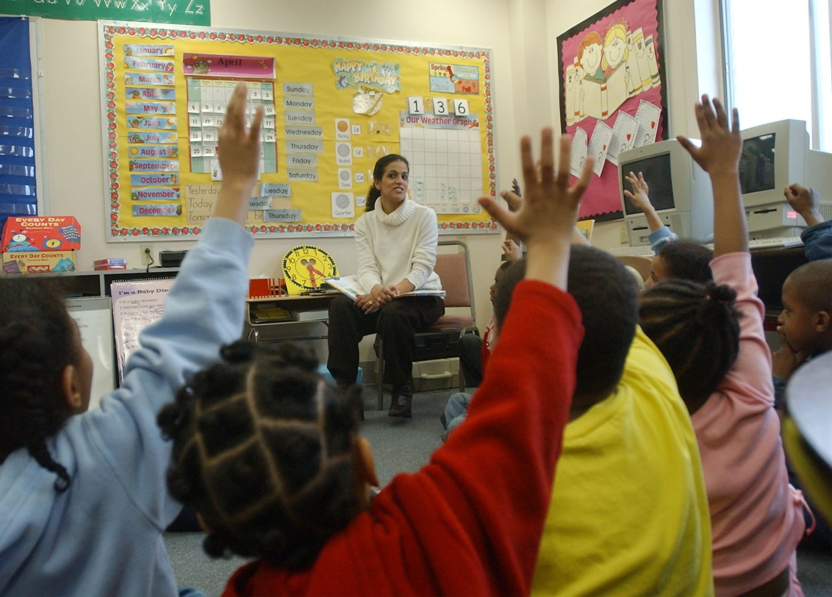 "A Brockton elementary school class is seen in 2004. Years before, in the 1990s, students in Brockton and 15 other cities and towns sued the state, arguing that it was failing to provide students the opportunity to receive an ""adequate education"" and so was violating the Massachusetts Constitution. (Chitose Suzuki/AP)"