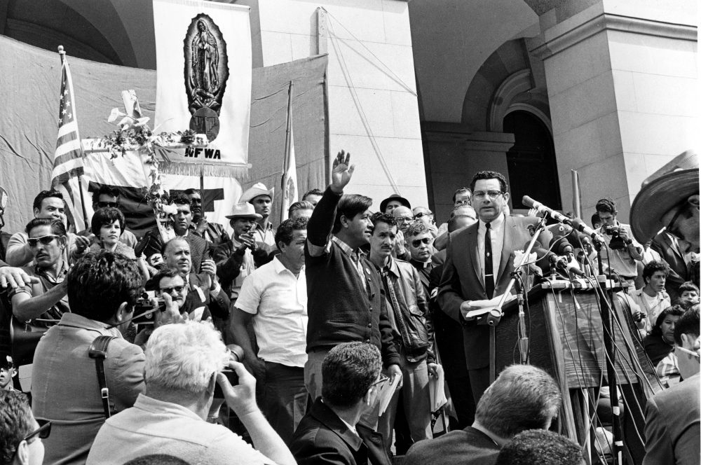 In this April 11, 1966, file photo, Cesar Chavez, leader of the Delano grape pickers' strike, waves to the crowd from the steps of the California Capitol in Sacramento. Chavez led his strikers and sympathizers on an over 300-mile, 25-day pilgrimage from Delano to the capitol in an attempt to meet with Gov. Brown on Easter Sunday. (AP Photo/File)