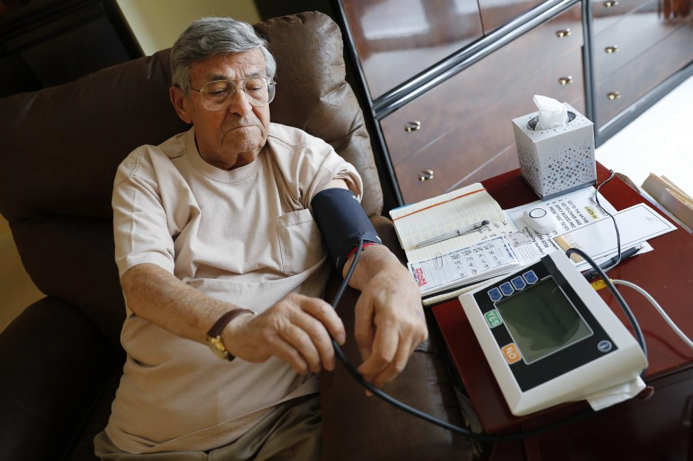 In this May 29, 2018, photo, Sidney Kramer, 92, uses a remote medical monitoring system to check his vital signs at his home in Bethesda, Md. (Pablo Martinez Monsivais/AP)