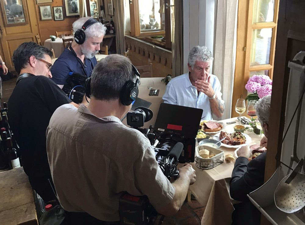 In this photo taken on Monday, June 4, 2018, Anthony Bourdain is seen with a film crew at Wistub de la Petite Venise, a restaurant in Colmar, France. (Etienne Butterlin via AP)