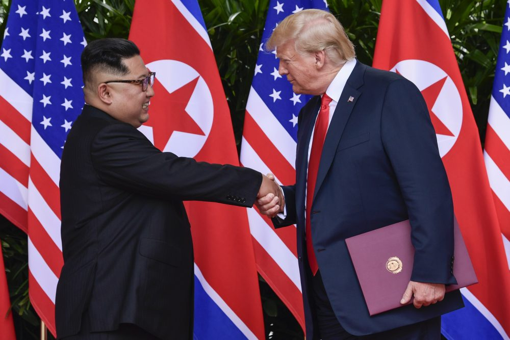 North Korea leader Kim Jong Un and U.S. President Donald Trump shake hands at the conclusion of their meetings at the Capella resort on Sentosa Island Tuesday, June 12, 2018 in Singapore. (Susan Walsh/AP)